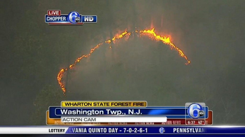 The odor of smoke from a brush fire in New Jersey has traveled as far north as New York City.
