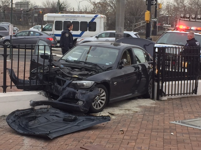 The car came to rest at the gate of Maspeth Memorial Square