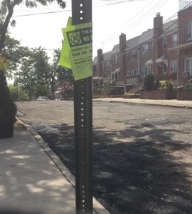 This green sign should have been removed Monday by DOT after DOT was finished and they knew they would not be working on the block Tuesday. Instead the entire block of residents had to scramble to take up spots blocks away.